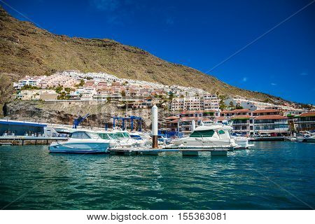 Los Gigantes harbor with its small houses and yachts Tenerife Spain