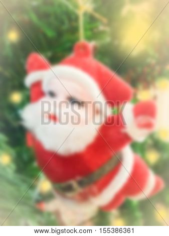 de-focused background Santa doll hanging on christmas tree