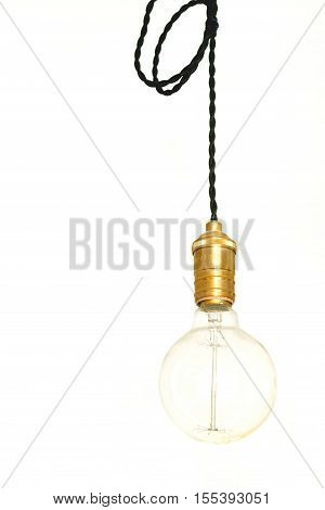 Vintage filament light bulb hanging on black cable isolated on white background