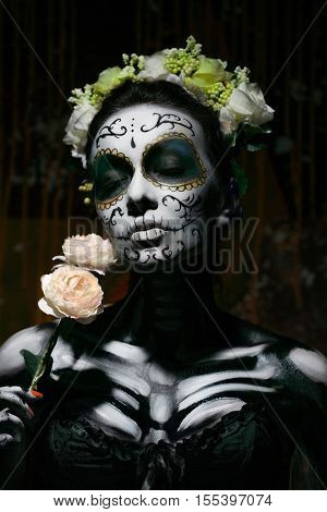 Portrait of a dead woman with flower