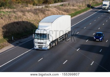 Road transport. White lorry on the motorway