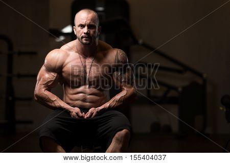 Healthy Man Flexing Muscles