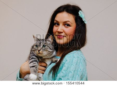 Young pretty brunette gril and her cat