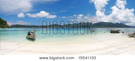 beach and sea with longtail boat, thailand