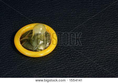 Yellow Condom On Leather