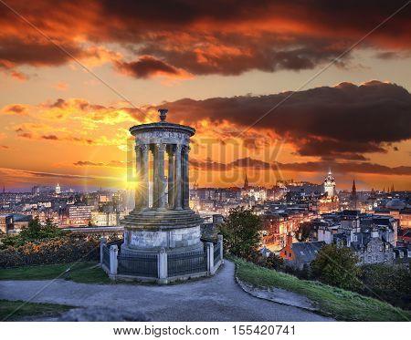 Edinburgh Against Sunset With Calton Hill In Scotland