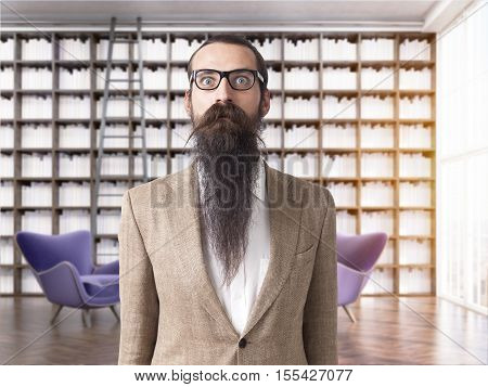 Portrait of baffled man wearing glasses with long beard standing in his home library. 3d rendering