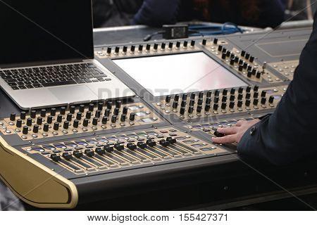 Sound mixer board at a live concert