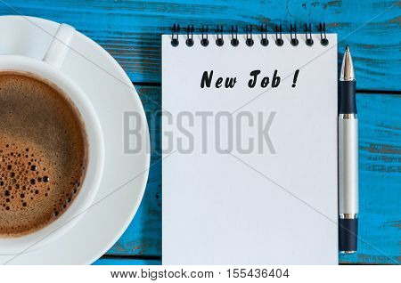 NEW JOB - inscription in notepad near morning cup of coffe. Possibility, chance or opportunity concept.