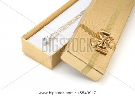 gift. golden box with pendant