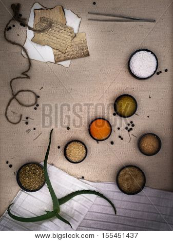 Alchemy Lab. dried herbs, salt, flasks, pipettes recipes on the old canvas