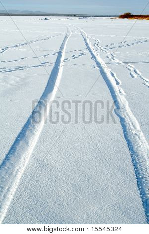 Abstract design - tire tracks in snow