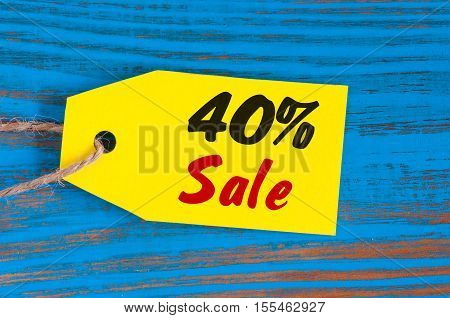sale minus 40 percent. Big sales fourty percents on blue wooden background for flyer, poster, shopping, sign, discount, marketing, selling, banner, web