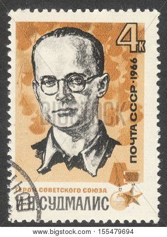 MOSCOW RUSSIA - CIRCA OCTOBER 2016: a post stamp printed in the USSR shows a portrait of I. Yu. Sudmalis the series