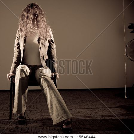 Depressed Woman Sitting On The Chair
