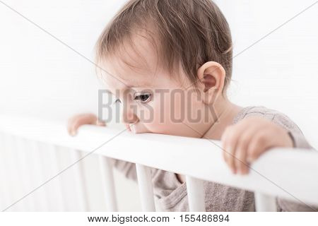 Portrait Of Cure Baby In His Cot, Isolated On White