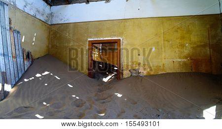 Interior of ruined house in ghost-town Kolmanskop Namibia