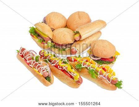 Several different hamburgers with beef patty and several different hot dog with frankfurter and vegetables on a dish and near it on a light background