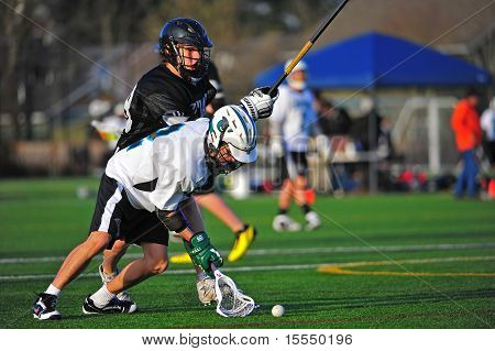 Boys Lacrosse scooping up the ball