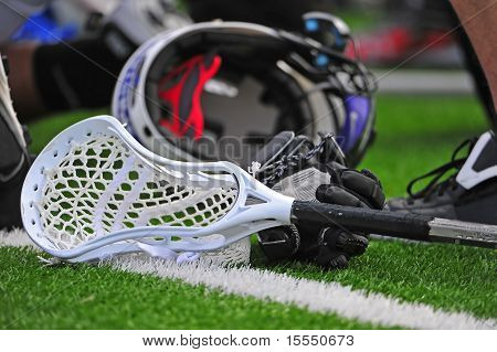 Boys lacrosse stick and helmet