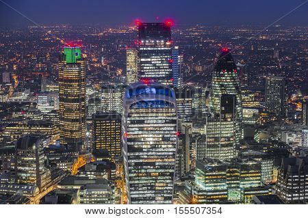 London England - Aerial skyline view at of London's famous business district with skyscrapers and offices at night