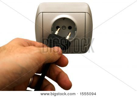 Man Plugging Wall Socket