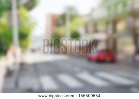 Blurred view of quiet street with road and high buildings