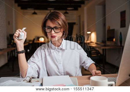 Fashion business woman. thoughtful. sits by the table