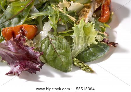 Salad mix with rucola frisee radicchio and lamb's lettuce. Isolated on white background.