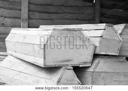 Wooden coffins of various sizes / black and white photo in a retro style