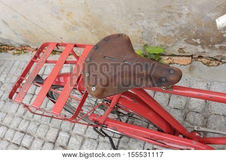 Bag Black bicycle red travel saddle Closeup old brick wall background