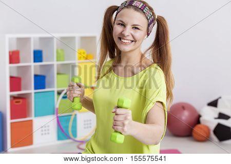 Teenager Holding Dumbbells
