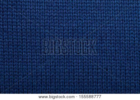 Deep blue knitted fabric textured background