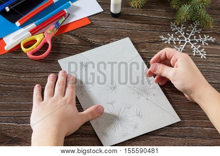 Child Sewing Needle Details Paper Snowflakes. The Child Makes A Greeting Card With A Snowman. Glue,