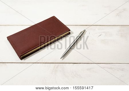 Clerk note book tablet with pen for writing on table