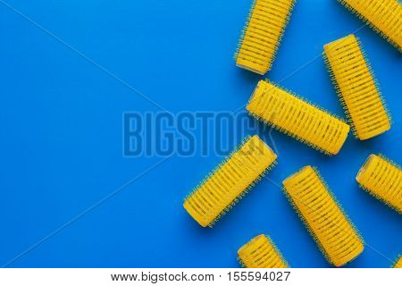 yellow hair curlers on the blue background