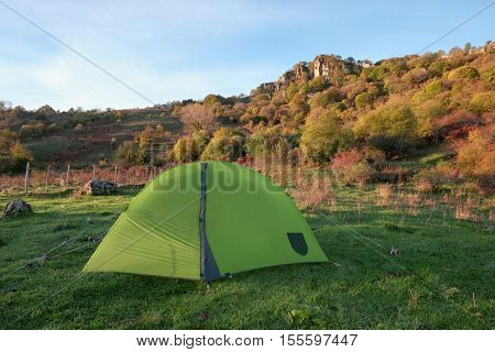 autumnal landscape with green tent in Nebrodi Park, Sicily