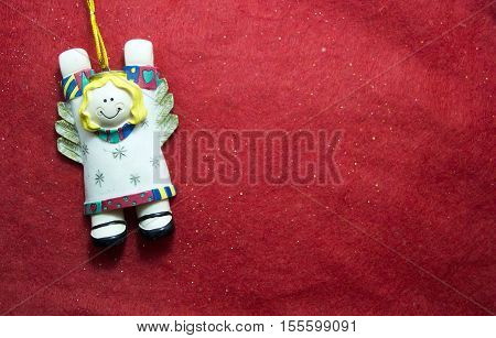 Decoration of gypsum christmas angel on red background
