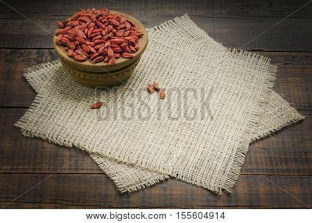 Goji. Goji berries in bowl. Goji berries on wooden background. Goji berries for health.Goji berries. Red dried goji berries.