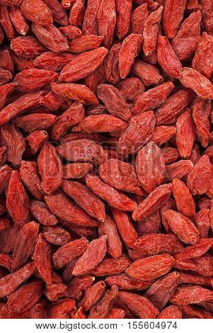 Detailed many Goji berries background. Goji. Goji berries. Goji berries for health.  Red dried goji berries.