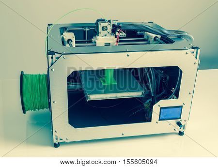 3d printer with bright green filament picture