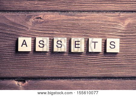 Asset management word collected of wooden elements with the letters