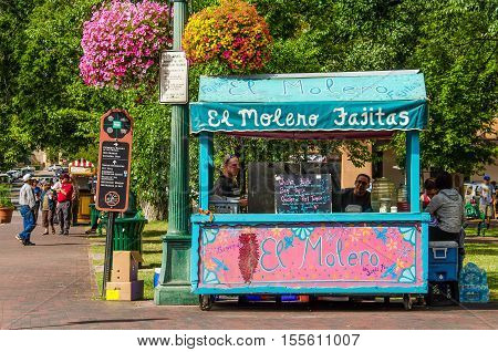 Santa Fe, USA - July 30, 2015: Colorful pink and blue mexican El Molero Fajitas food stand in downtown
