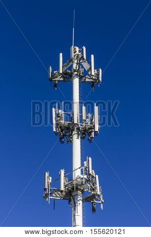 Telecommunications And Wireless Equipment Tower With Directional Mobile Phone Antenna - Portrait