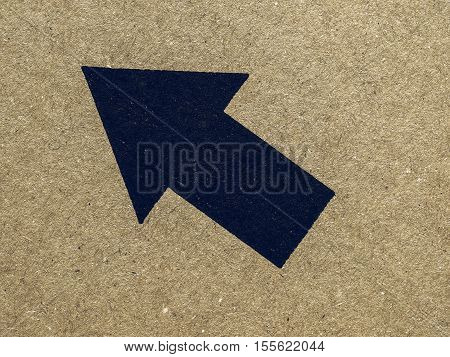 Vintage Looking Black Arrow On Cardboard