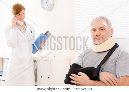 Senior Patient Broken Arm In Doctor Office