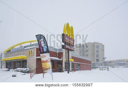 Washington D.C. USA - January 23 2016: McDonald's snow-covered building during snowstorm.