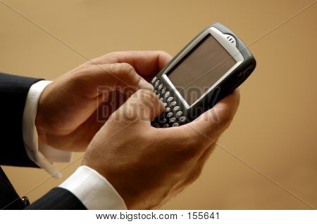Mobile Businessman Sending A Text Message
