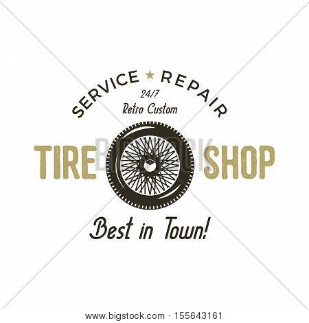 Car garage vintage label. Retro illustration of car garage emblem. Vector car garage logo with tire and typography elements. Tire shop service repair. Use as car garage logotype, tee shirt, prints.