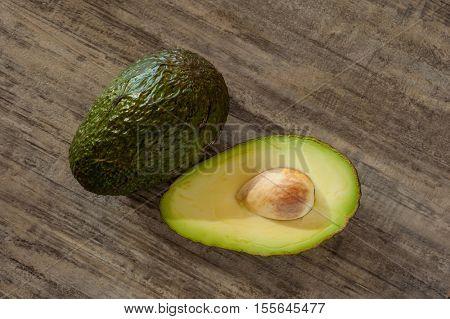 Extreme close-up image of avocado on wood background